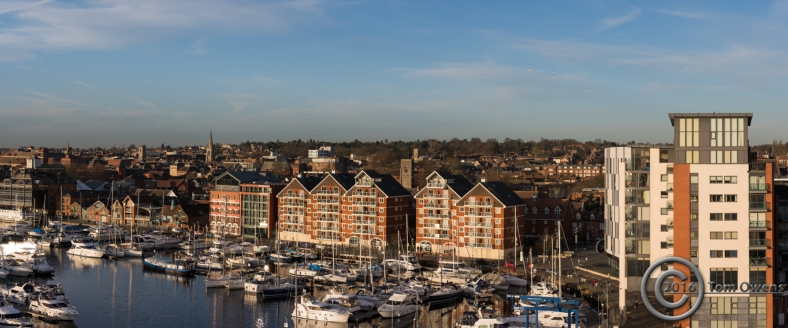 Dock and townscape with yachts